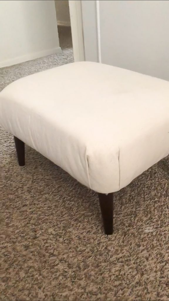 Ottoman reupholstered with dropcloth canvas
