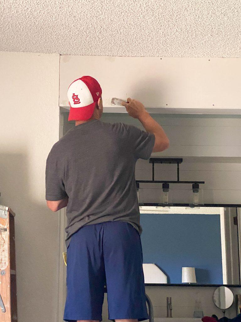 Mudding and taping drywall header
