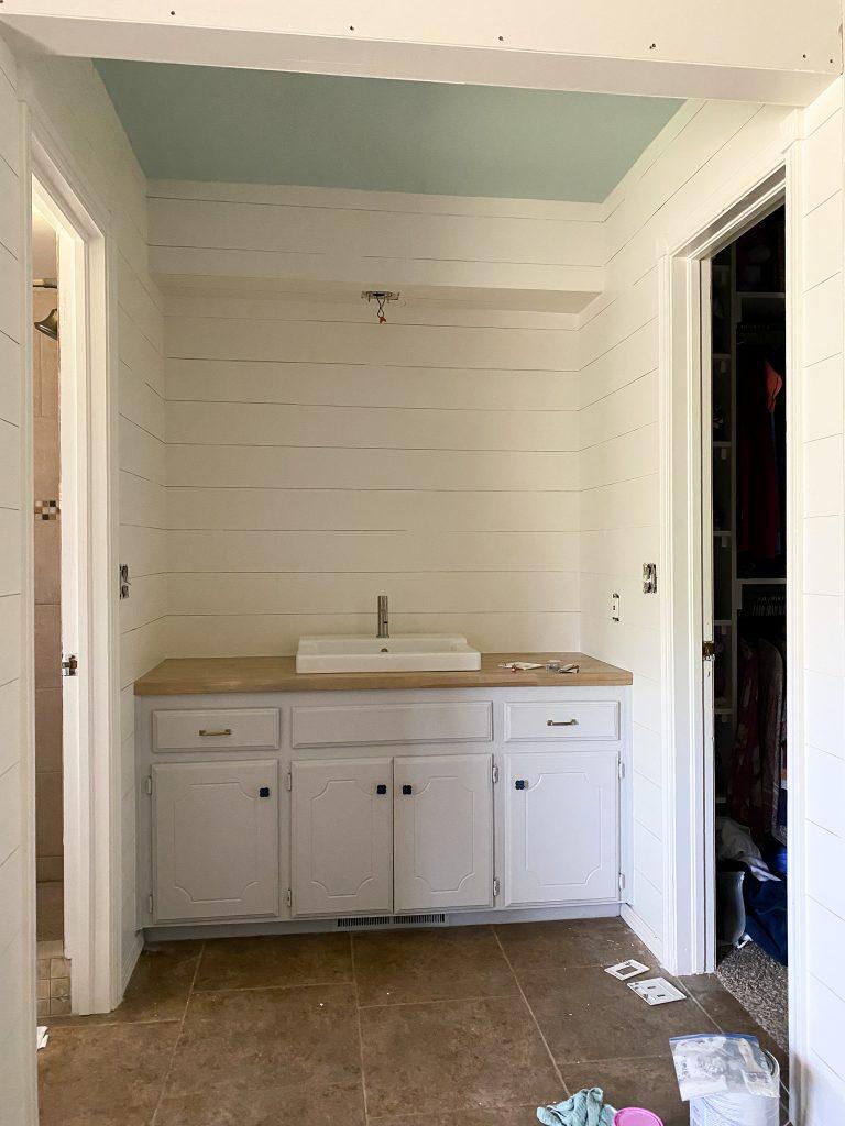 Painted shiplap in master bathroom update