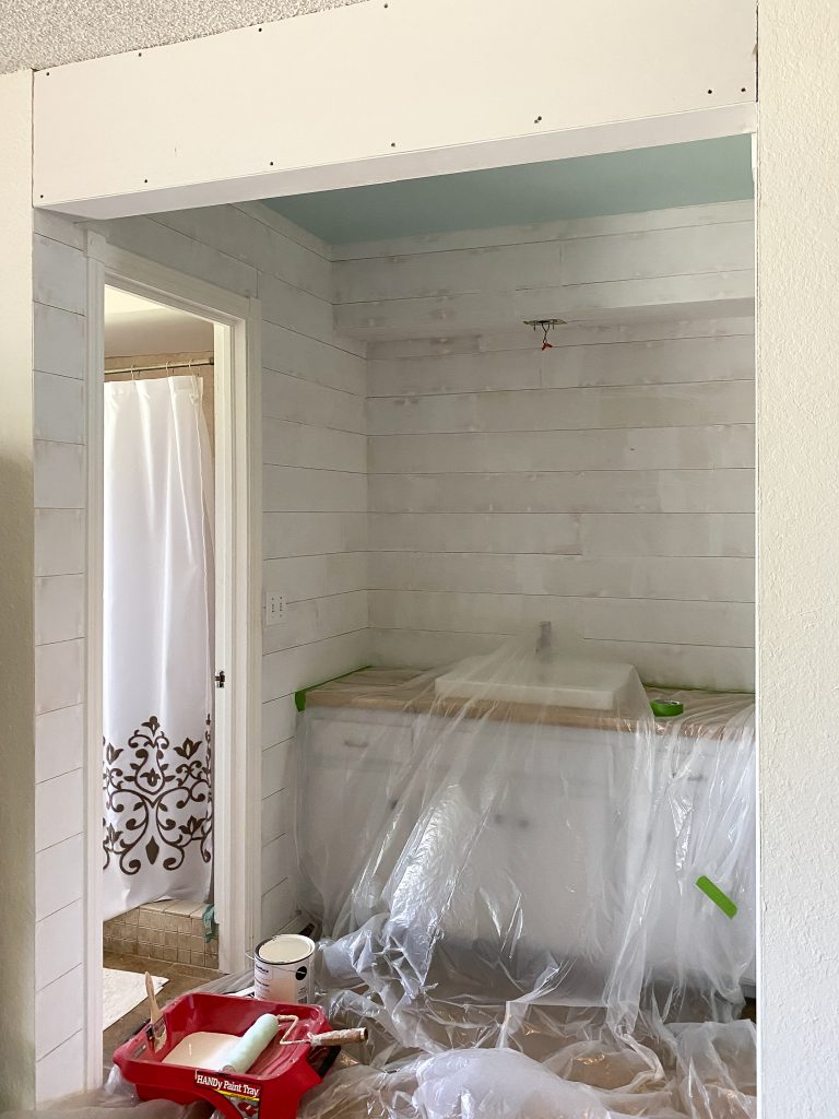 Shiplap installed in master bathroom