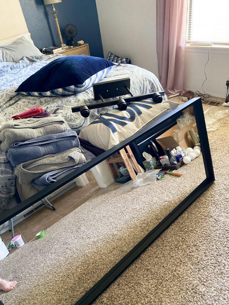 Sneak peek of mirror and light fixture